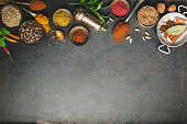 Herbs and spices on dark background - turkish, indian, asian cooking concept, flat lay, space for text