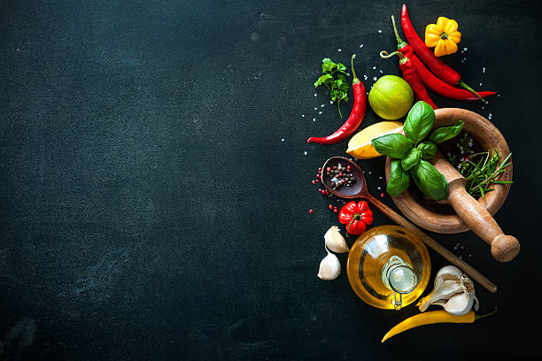 Herbs and spices on slate background - foto de stock