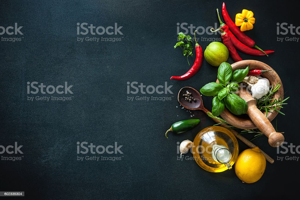 Herbs and spices on slate background stock photo