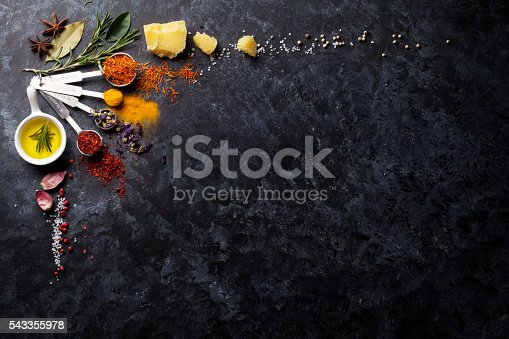 istock Herbs and spices over black stone 543355978