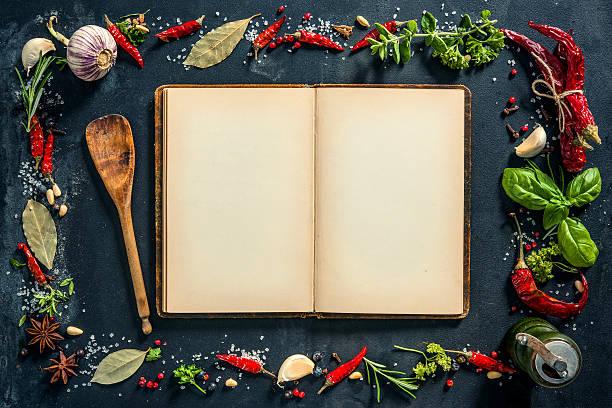 herbs and spices with a recipe book - italienische speisekarte stock-fotos und bilder