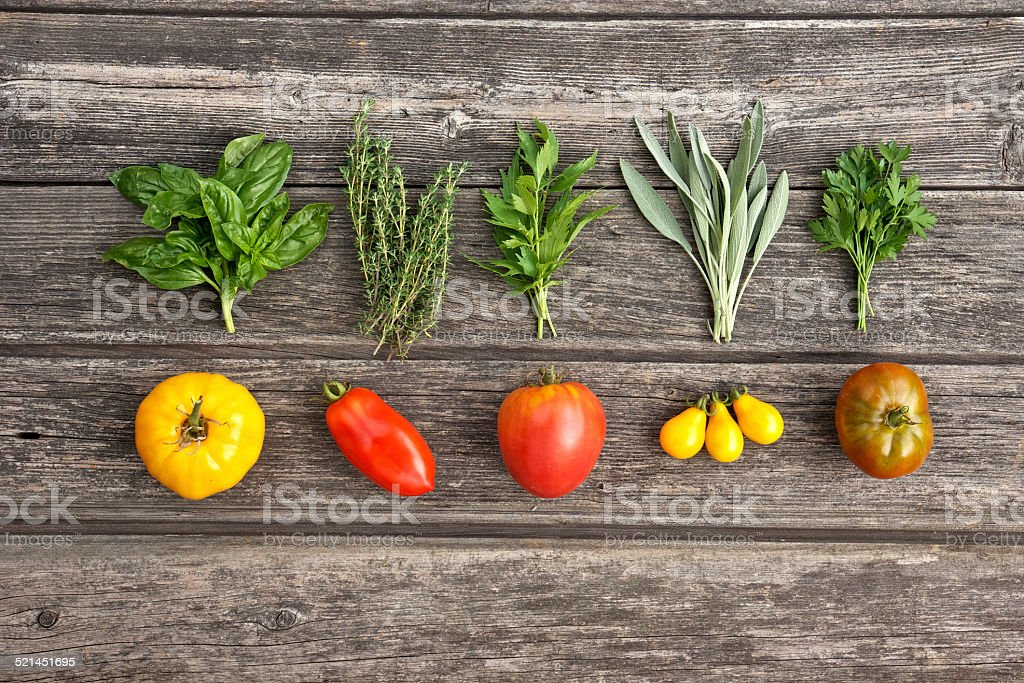 Herbs and vegetables on the wooden board stock photo
