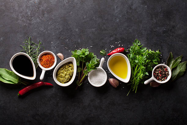 Herbs, condiments and spices Herbs, condiments and spices on stone background. Top view with copy space vinegar stock pictures, royalty-free photos & images