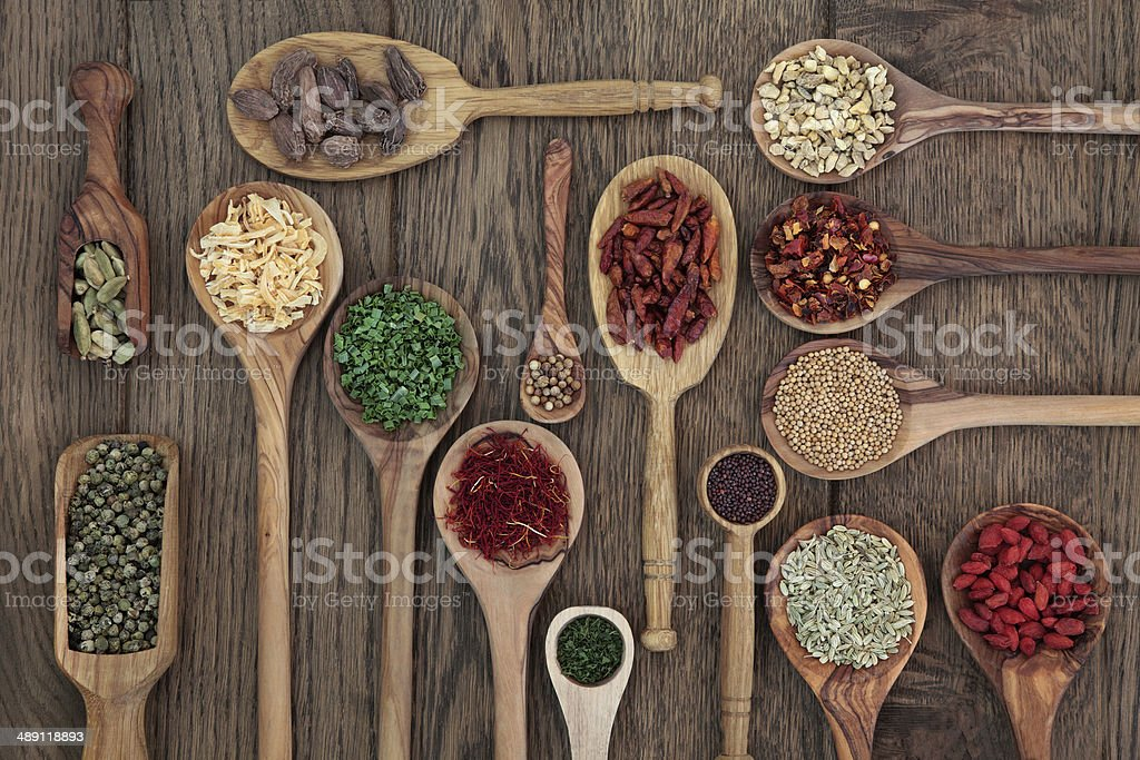 Herbs in Spoons stock photo