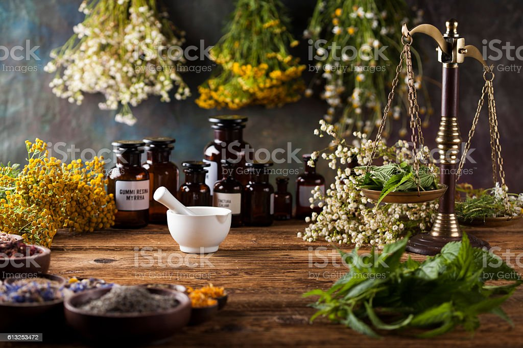 Herbs medicine,Natural remedy and mortar on vintage wooden desk – Foto
