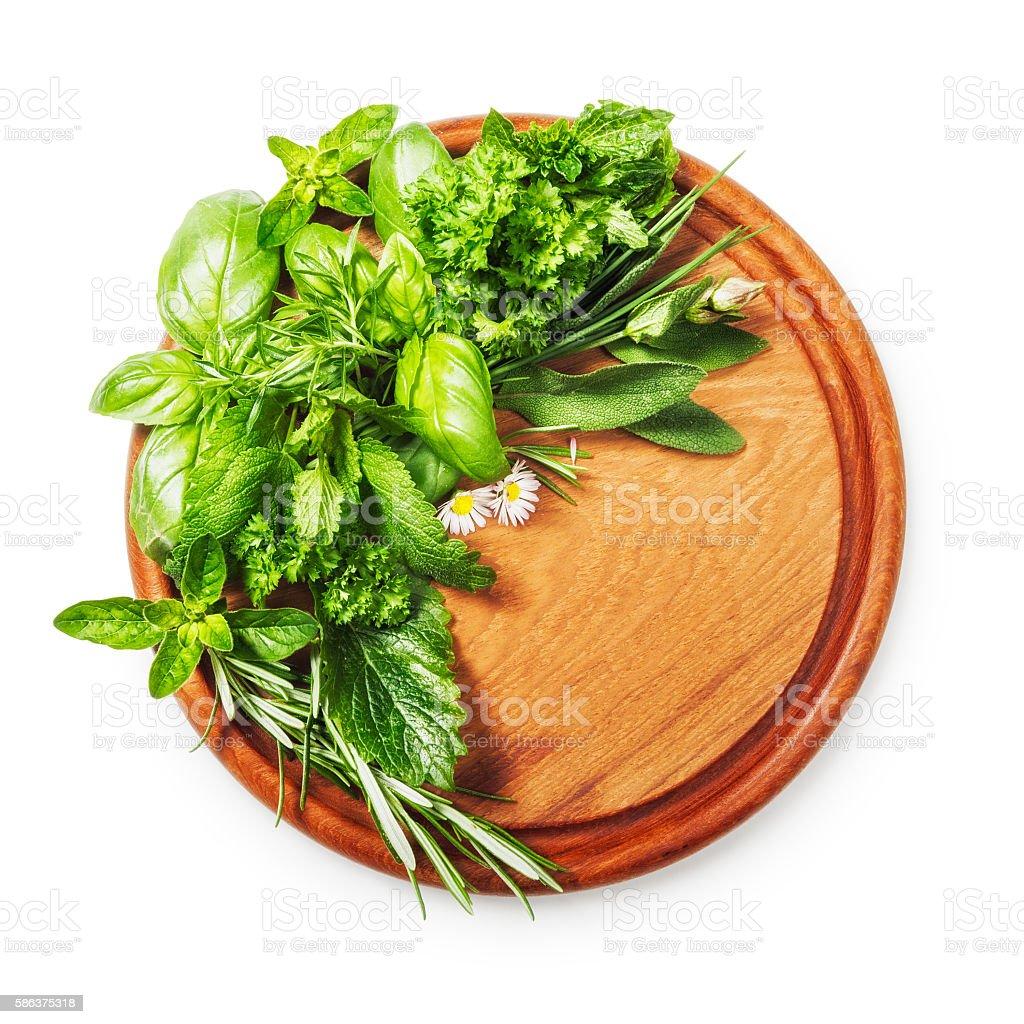Herbs on cutting board stock photo