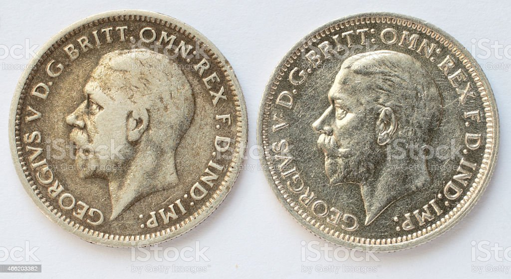 Two 1936 silver sixpences difference in wear obverse stock photo
