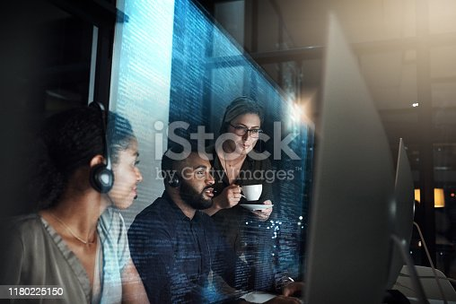 Cropped shot of an IT support team working the late shift in their office