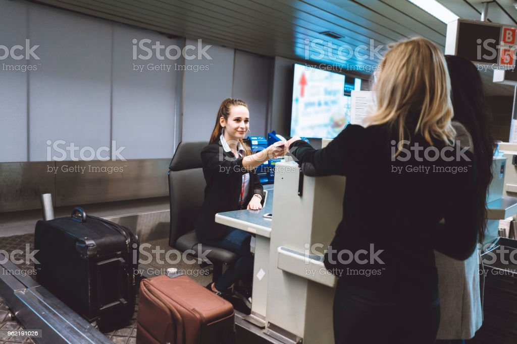 Here is your pass lady stock photo