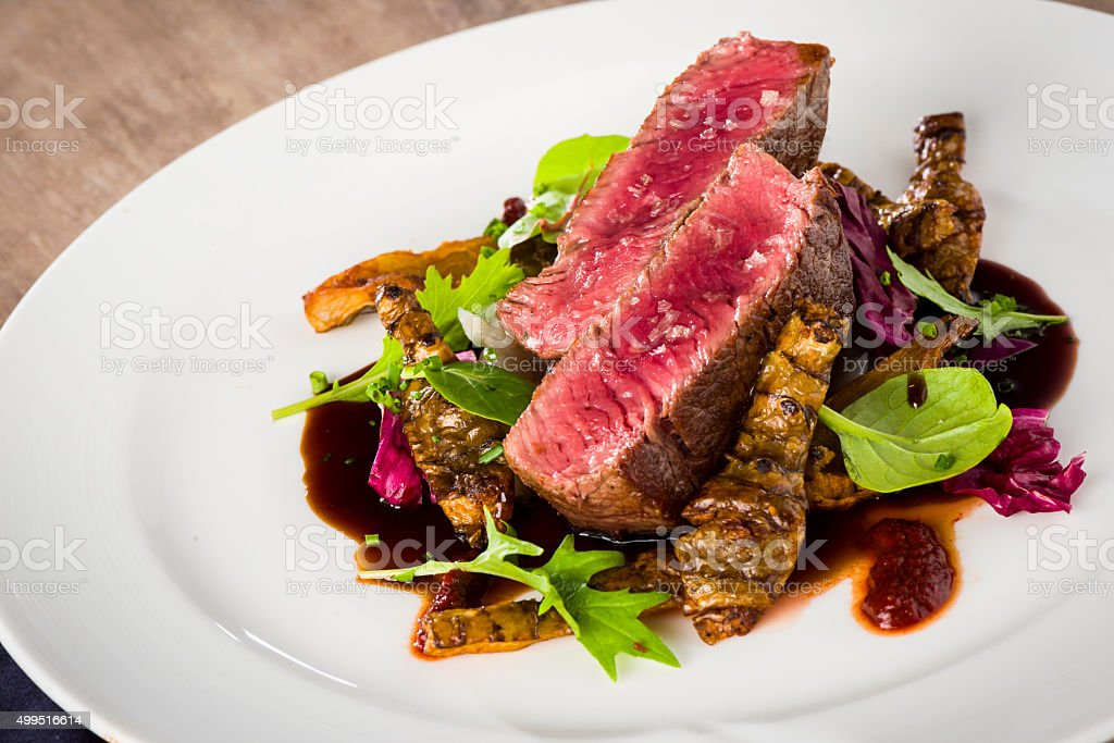 Hereford Irish prime beef fillet, tupinambur, anticucho sauce stock photo