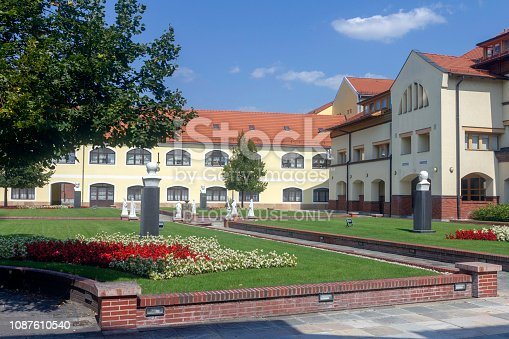 Herend, Hungary - 08 29 2018: The building of the world famous Herend Porcelain Manufactory in the city of Herend, Hungary on a summer afternoon.