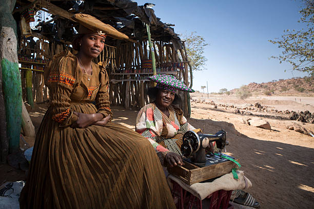 herero women - angola stock photos and pictures