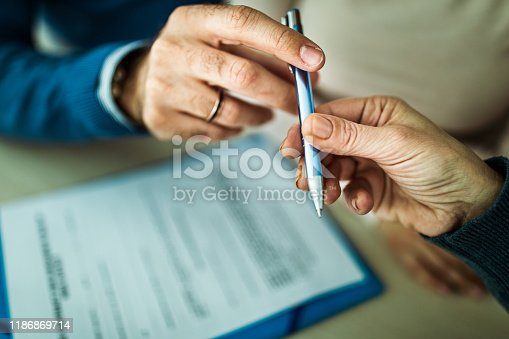 1072035844istockphoto Here's a pen for signing your contract! 1186869714