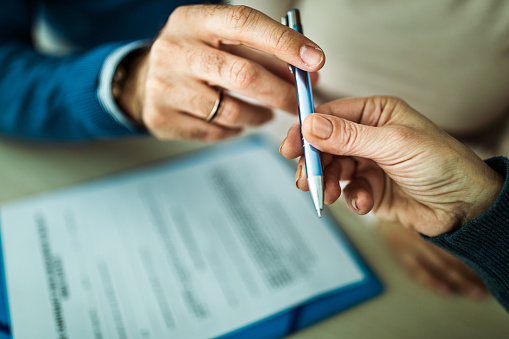1072035844 istock photo Here's a pen for signing your contract! 1186869714