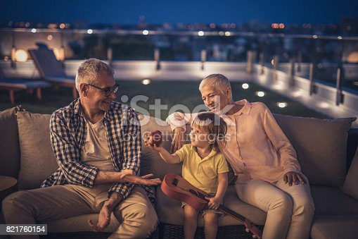 istock Here's an apple for you grandpa! 821760154