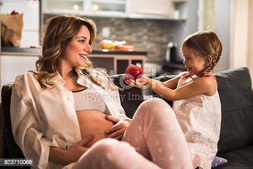 istock Here's an apple for you mommy! 823710068