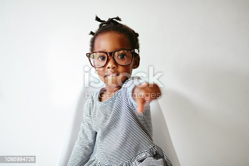 Portrait of an adorable little girl pointing with attitude