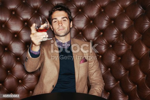 A handsome young man drinking in a club