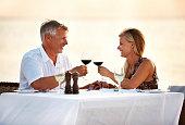 Shot of a mature couple enjoying a romantic dinner on the beachhttp://195.154.178.81/DATA/shoots/ic_781021.jpg