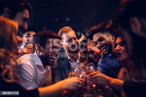 Group of friends toasting at a party