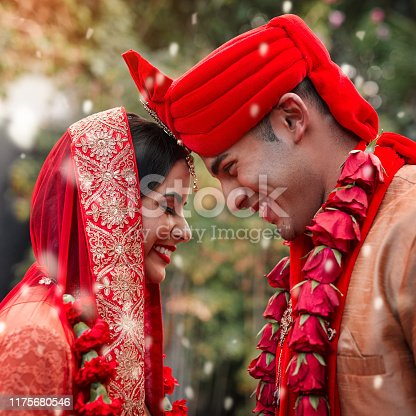 Cropped shot of a young hindu couple on their wedding day