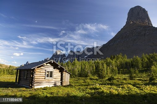 Heritage Landmark Log Cabin on a Green Alpine Meadow near Wolverine Pass below Rockwall Mountain Peak, Kootenay National Park Canadian Rockies