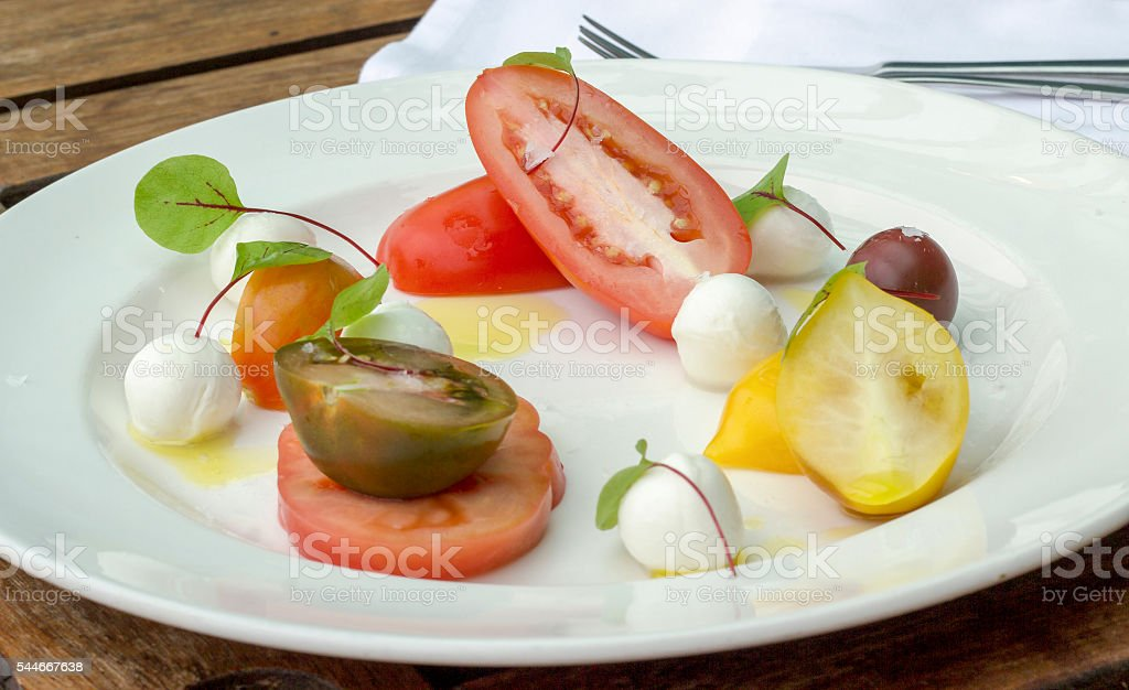 Heritage tomato salad with bocconcini stock photo
