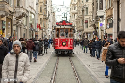 Istanbul, Turkey - Jan 25  2018: Heritage trams of a Taksim-Tunel Nostalgia Tramway line operates on Istiklal Street between Taksim Square and underground railway line - Tunnel. Istanbul, Turkey