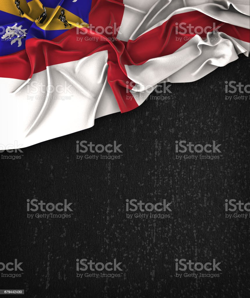 Herm Flag Vintage on a Grunge Black Chalkboard With Space For Text stock photo