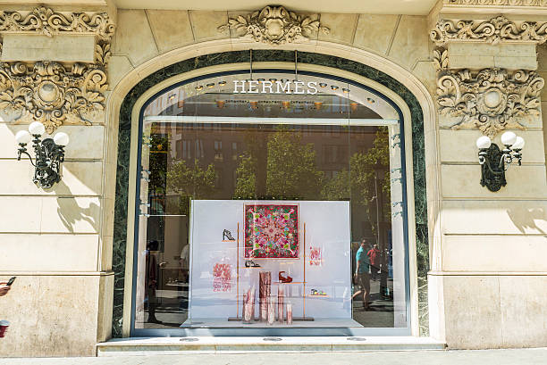 Hermes shop, Barcelona Barcelona, Spain - May 25, 2016: Hermes shop located on Passeig de Gracia, one of the most expensive streets in Europe. gracia baur stock pictures, royalty-free photos & images