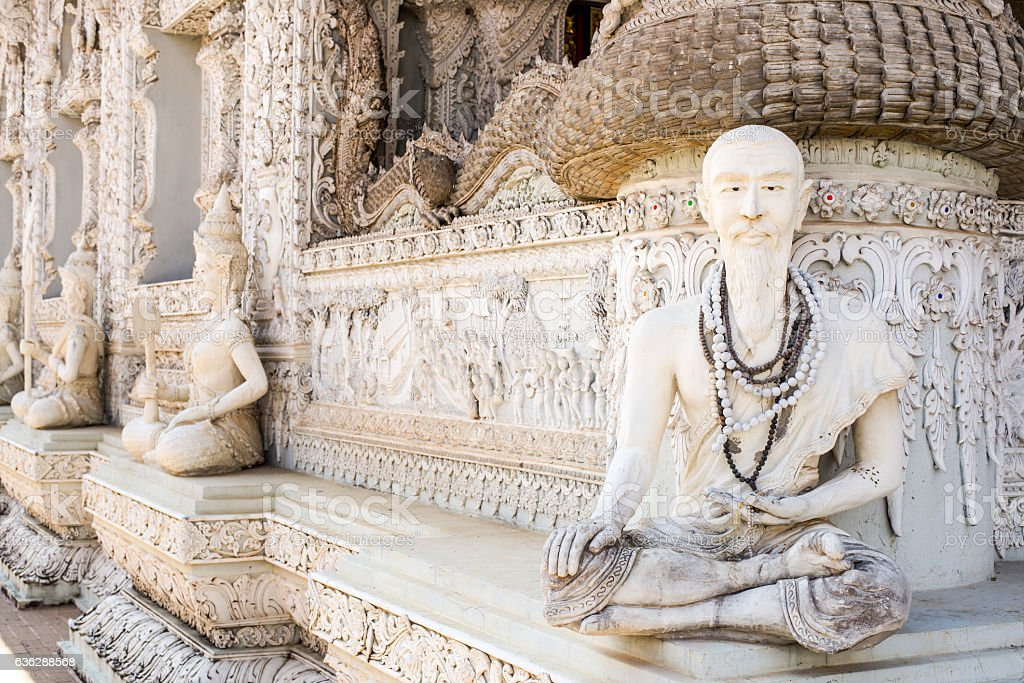 Hermit statue in the temple of Thailand stock photo