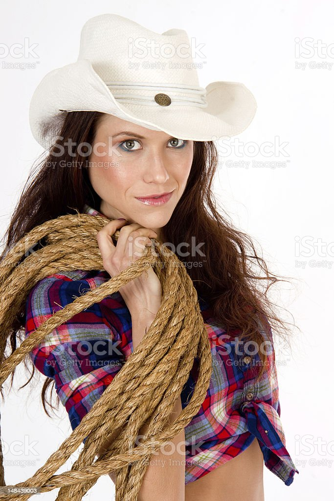 Hero Cowgirl Wearing White Cowboy Hat Holds Section of Rope royalty-free stock photo