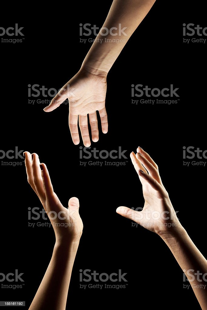 Hero Giving a Helping Hand to Someone in Need stock photo
