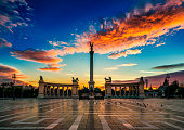 Heroes' Square is one of the major squares of Budapest, Hungary, rich with historic and political connotations. Its iconic statue complex, the Millennium Memorial, was completed in 1900, the same year the square was named \