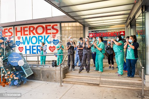 Manhattan, New York, USA - May 21, 2020: Healthcare workers at the Lenox Health Emergency room entrance are greeted to cheers and thanks for their essential service during the covid-19 pandemic in New York city.