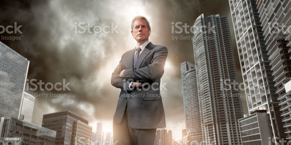 Heroic Businessman against City Skyscape royalty-free stock photo