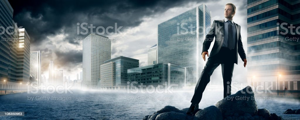 heroic businessman in city royalty-free stock photo