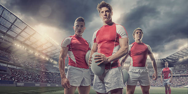 heroic rugby players standing with ball on pitch in stadium - rugby fotografías e imágenes de stock