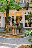 Baden Baden, Germany - May 6, 2013: Heron Fountain Reiherbrunnen in Sophienstrasse Street at Old city of Baden Baden at Baden Wurttemberg region, Germany. Cityscape view of square and architecture