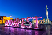 Hero's Square in Budapest with BUDAPEST sign during the Spring Festival at night. (no people)