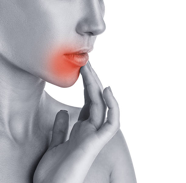 Herpes concept Herpes concept. Close-up of young woman touching lips affected by herpes herpes stock pictures, royalty-free photos & images