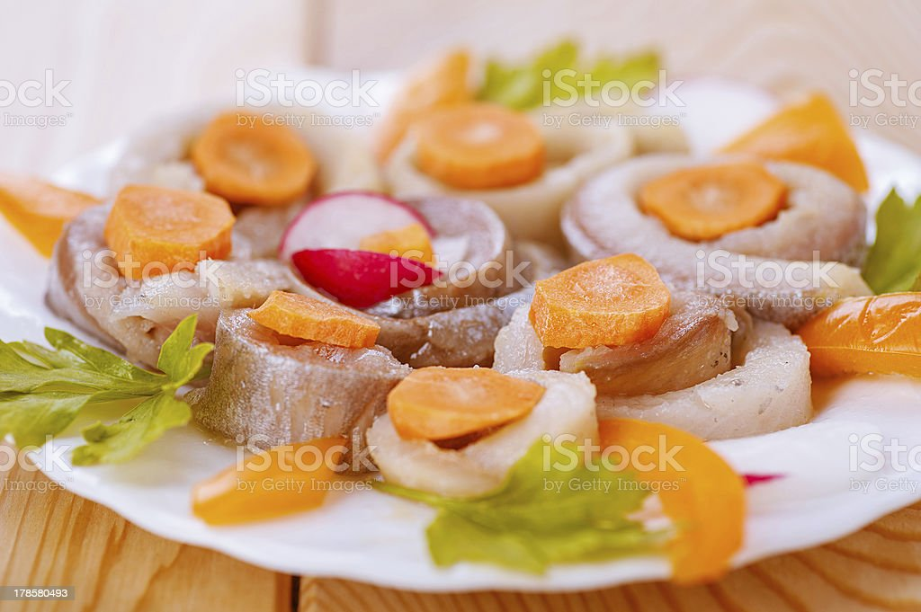 Herring, coiled with carrots and parsley royalty-free stock photo