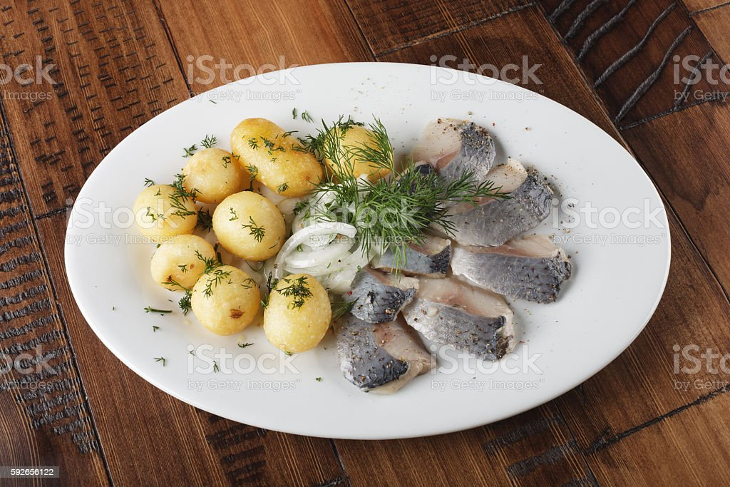 Herring fish with young potato stock photo