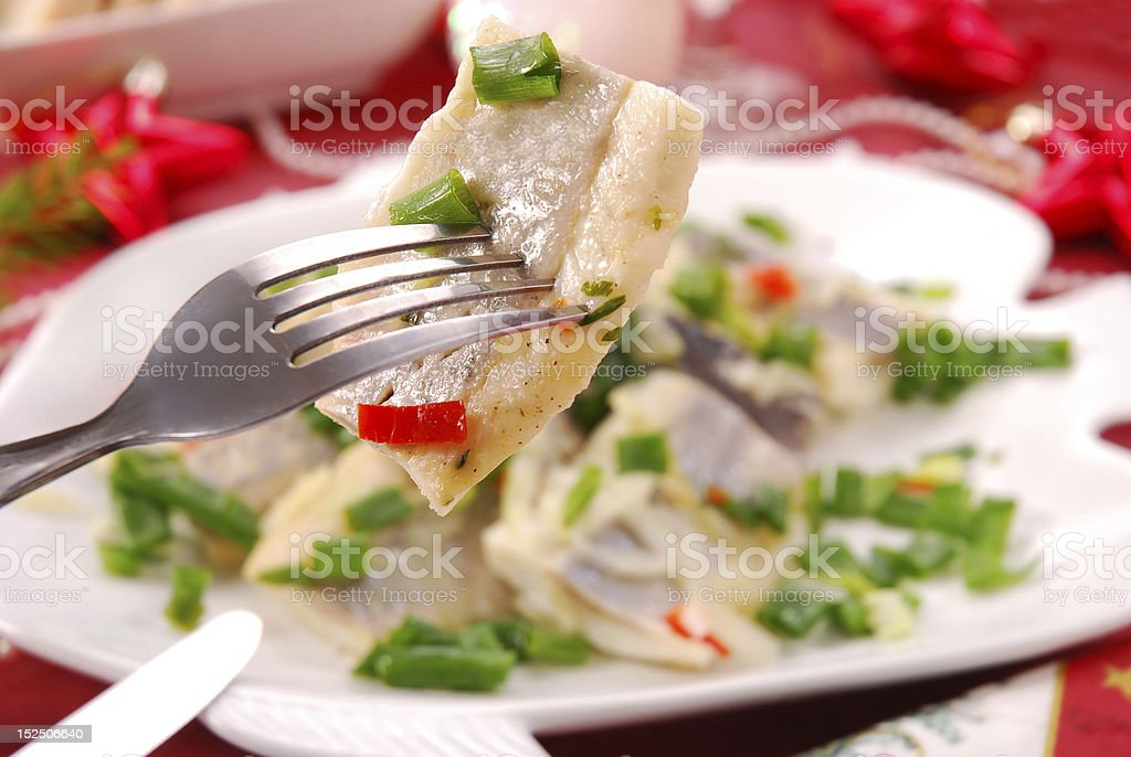 herring in oils with chives and onion stock photo