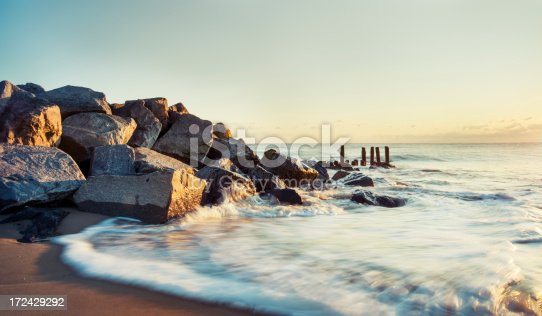 A jetty at Herring Point in Henlopen State Park at sunrise.  Motion blur on water.