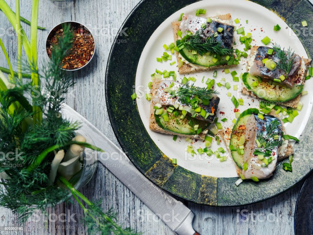 Herring sandwiches on the table stock photo