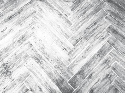 whitewashed herringbone black and white pattern wall