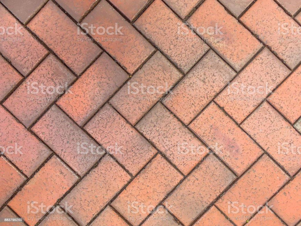 Herringbone Brick pavers background stock photo