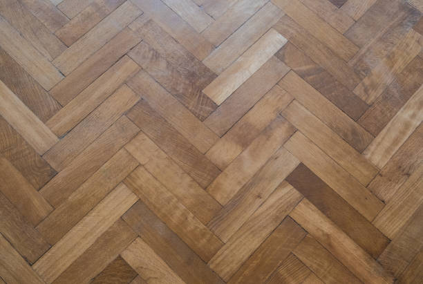 herringbone parquet floor - old wooden floor stock photo