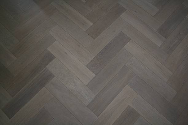 Herringbone Parquet oak floor stock photo